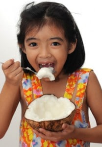 girl-eating-coconut-208x300