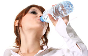 woman-drinking-water-from-a-bottle