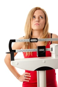 woman-standing-on-the-scale-frustrated1