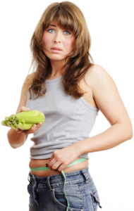 unhappy-woman-holding-a-vegetable