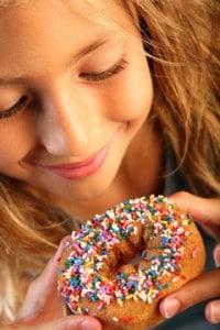 young-girl-looking-at-doughnut-200x300