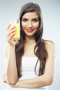 young-woman-holding-a-glass-of-orange-juice
